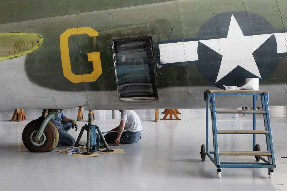 Conservation Officers at the Imperial War Museum Duxford work on the B-17 Flying Fortress Mary Alice in their American Air Museum on May 10, 2011 near Cambridge, England.
