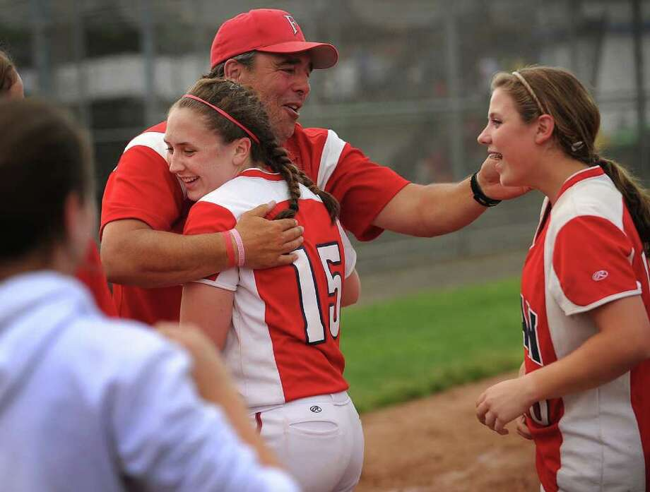 Foran coach Jeff Bevino hugs players Gina Georgetti, left, and Marissa Bruno after his team won the Class L state championship softball game at West Haven High School on Monday, June 13, 2011. Foran of Milford defeated Bacon Academy 3-0. Photo: Brian A. Pounds / Connecticut Post