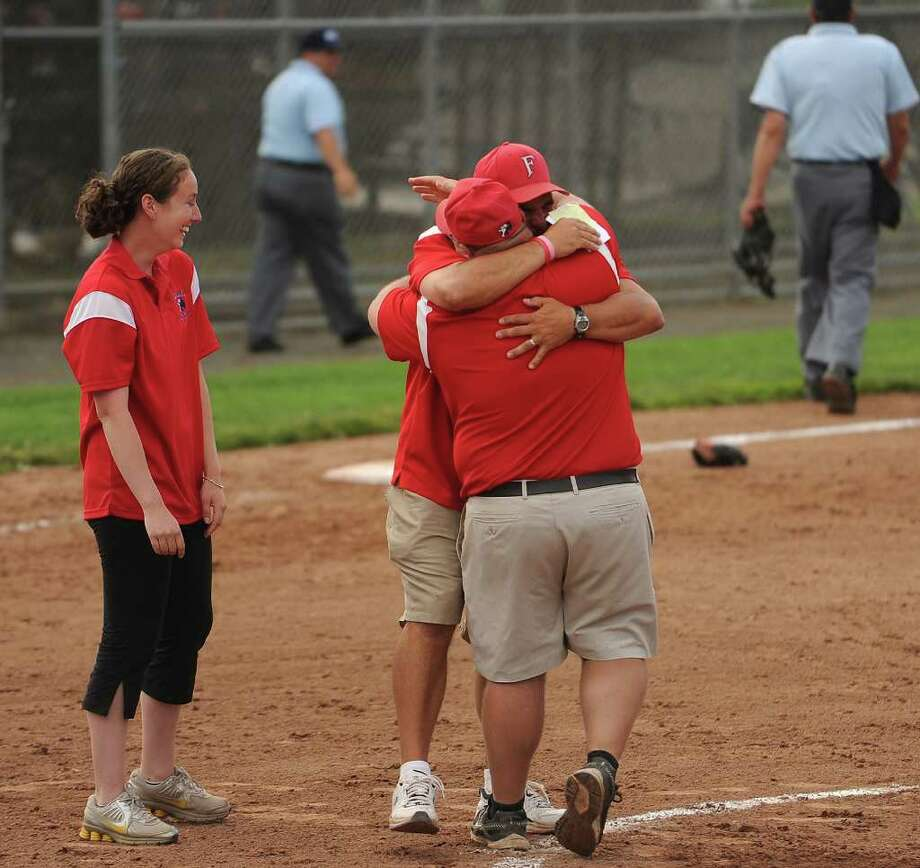 Foran coaches share a big hug after winning the Class L state championship softball game at West Haven High School on Monday, June 13, 2011. Foran of Milford defeated Bacon Academy 3-0. Photo: Brian A. Pounds / Connecticut Post