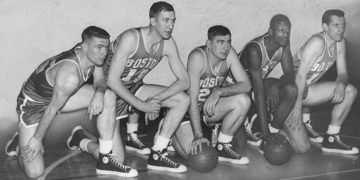 Jack Nichols, 1957, Boston Celtics: Nichols, far right, attended Everett High School before splitting his college career between Washington and USC. The 6-foot-7 forward and center played six seasons in the NBA with the Washington Capitols, Tri-Cities Blackhawks and Milwaukee Hawks before hitching his wagon to Bill Russell, second from right, and the Celtics for his final three seasons. In 1957, those Celtics beat the St. Louis Hawks in seven games. Nichols retired in 1958 and later served as the team dentist for the Huskies and the Sonics. He died in 1992.