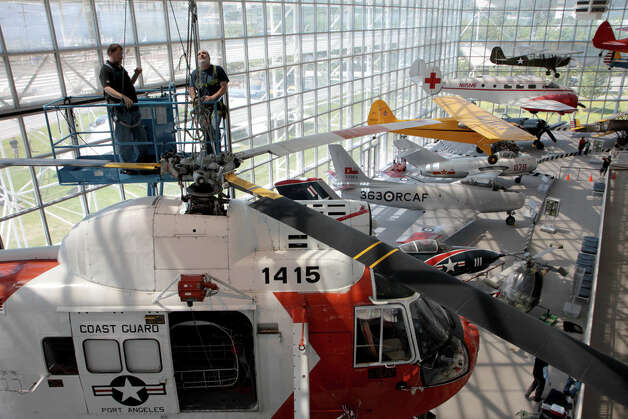 The Museum of Flight installs its former Coast Guard Sikorsky HH-52 Seaguard amphibious helicopter in its Great Hall on Monday, June 13, 2011. Photo: Ted Huetter/The Museum Of Flight