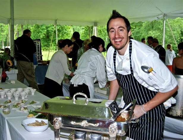 "Referred to admiringly as the ""rock star"" chef, Chef Derek Wagner from Providence, Rhode Island, prepared an impressive array of ""Farm to Table"" specialties from his restaurant ""Nicks on Broadway"" at the Glass House Dine with Design event, Saturday, June 12, 2011. Photo: Jeanna Petersen Shepard / New Canaan News"
