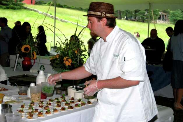 "Chef Lee Chizmar from ""Bolete"" in Bethlehem, Pennsylvania, is busy putting together an delectible tray of House Made Head Cheese, Black Pepper Crackers, Porcini Mustard, and Pickled Mushroooms. Photo: Jeanna Petersen Shepard / New Canaan News"