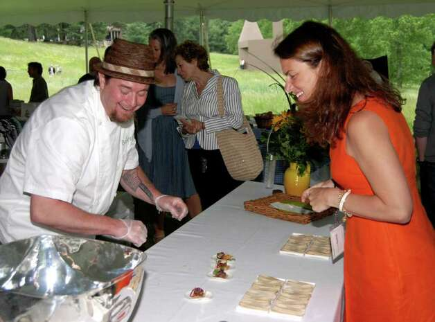 Chef Lee Chizmar shares some laughs with Pamela Duevel, President of Pamela Duevel Public Relations, who along with author of Harvest to Heat Darryl Estrine, were the inspiration behind the Dine With Design event. Photo: Jeanna Petersen Shepard / New Canaan News