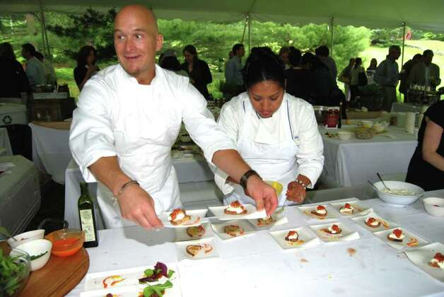 "Chef Brian Lewis attracts his own crowd here in New Canaan as his new restaurant ""elm"" with local partners approaches its opening.  Here, alongside Sonia Ceras, Chef Lewis teases local dining-out enthusiasts with Burrata accompanied with Wave Hill Garlic Toasts, Sweet Pepper Romesco, Marcona Almonds, and Mint. Photo: Jeanna Petersen Shepard / New Canaan News"