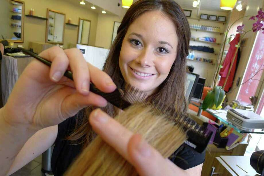 """Jaysie Walts owner of Hair Creations is kicking off """"Makeover Mondays,"""" a six-month campaign to make over women in the community, as selected by the community in Saratoga Springs, NY 2011.( Michael P. Farrell/Times Union ) Photo: Michael P. Farrell / 00013157A"""