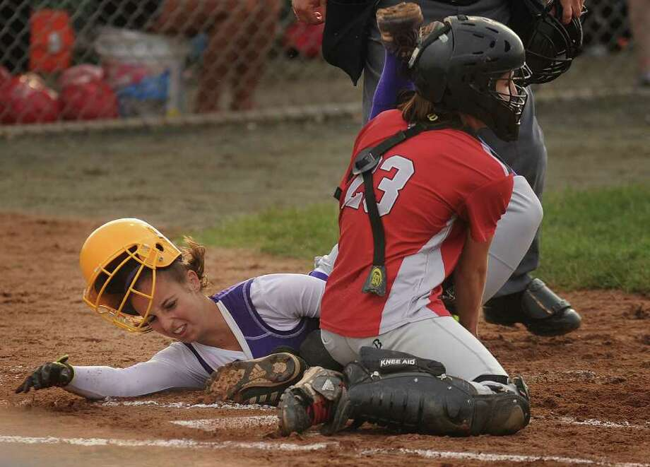 Westhill's Cassandra Kish is tagged out by Conard catcher Daniele Stevens in the first inning of the Vikings' 4-1 loss in the Class LL softball state championship game at West Haven High School on Monday, June 13, 2011. Photo: Brian A. Pounds / Connecticut Post