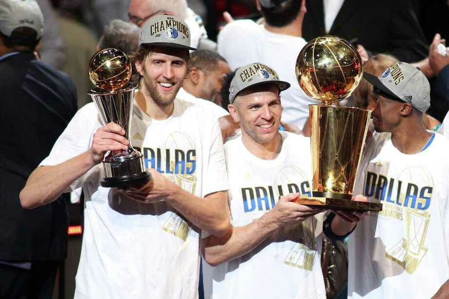 MIAMI, FL - JUNE 12:  (L-R) Finals MVP Dirk Nowitzki #41, Jason Kidd #2 and Jason Terry #31 of the Dallas Mavericks celebrate with the Larry O'Brien trophy after they won 105-95 against the Miami Heat in Game Six of the 2011 NBA Finals at American Airlines Arena on June 12, 2011 in Miami, Florida. NOTE TO USER: User expressly acknowledges and agrees that, by downloading and/or using this Photograph, user is consenting to the terms and conditions of the Getty Images License Agreement.  (Photo by Marc Serota/Getty Images) Photo: Marc Serota, Getty Images / 2011 Getty Images