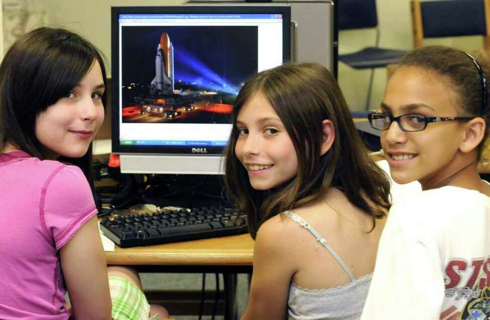 Fifth-grade students, left to right, Dana Betti, Kate Yager and Jordyn Catherall, whose science project was aboard the space shuttle Endeavor. The girls are students at Milton Terrace South in Ballston Spa.( Michael P. Farrell/Times Union )