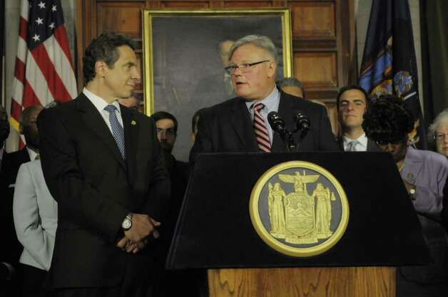 Governor Andrew Cuomo, left, listens as Senator Tom Duane addresses those gathered  for a press conference at the capitol on the issue of gay marriage on Monday afternoon, June 13, 2011 in Albany.  Senator Tom Duane is an openly-gay member of the Senate. The press conference was held to announce that 29 out of the 30 members of the Senate Democratic Conference have said they would vote yes on a gay marriage bill.   (Paul Buckowski / Times Union) Photo: Paul Buckowski