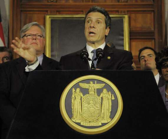 Senator Tom Duane, left, listens as Governor Andrew Cuomo addresses those gathered  for a press conference at the capitol on the issue of gay marriage on Monday afternoon, June 13, 2011 in Albany.  Senator Tom Duane is an openly-gay member of the Senate. The press conference was held to announce that 29 out of the 30 members of the Senate Democratic Conference have said they would vote yes on a gay marriage bill.   (Paul Buckowski / Times Union) Photo: Paul Buckowski