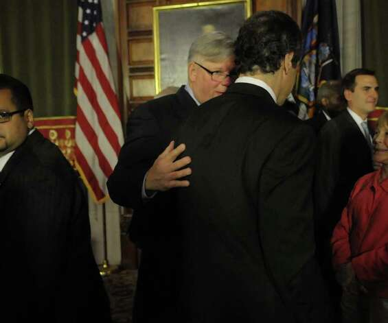 Senator Tom Duane, left, talks with Governor Andrew Cuomo following a press conference at the capitol on the issue of gay marriage on Monday afternoon, June 13, 2011 in Albany. Senator Tom Duane is an openly-gay member of the Senate.  The press conference was held to announce that 29 out of the 30 members of the Senate Democratic Conference have said they would vote yes on a gay marriage bill.   (Paul Buckowski / Times Union) Photo: Paul Buckowski