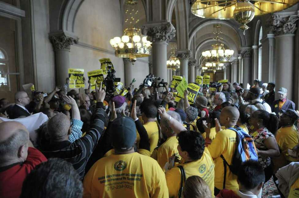 New York City tenants and tenant advocates hold a rally inside the capitol on Monday afternoon, June 13, 2011 in Albany. The group was calling on lawmakers to pass a bill with stronger rent laws and not just extend the existing rent control law. (Paul Buckowski / Times Union)