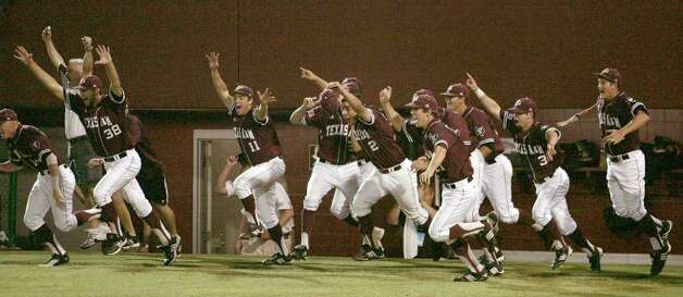 Texas A&M players rush the field after beating Florida State 11-2 in the teams' Super Regional game on Monday, June 13, 2011, in Tallahassee, Fla. Photo: Steve Cannon/Associated Press