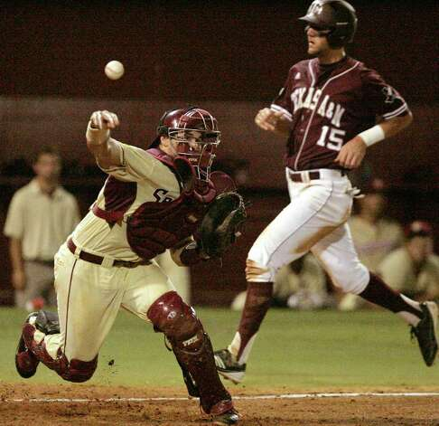 Florida State's Rafael Lopez throws to first after forcing out Texas A&M's Kenny Jackson at home in the seventh inning of the teams' Super Regional game on Monday, June 13, 2011, in Tallahassee, Fla. Photo: Steve Cannon/Associated Press