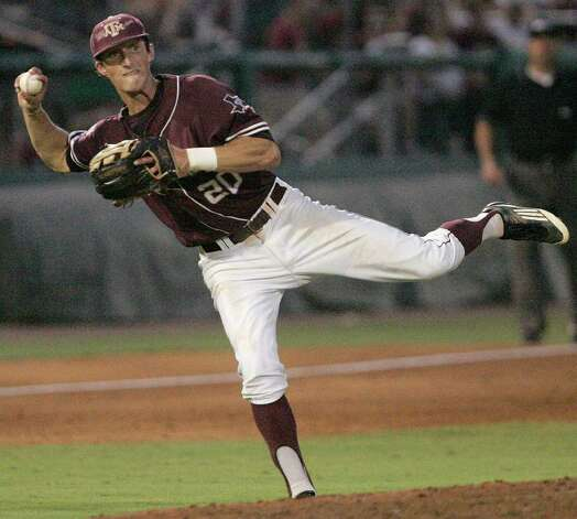 Texas A&M's Adam Smith throws out Florida State's Devon Travis in the sixth inning of the teams' Super Regional game on Monday, June 13, 2011, in Tallahassee, Fla. Photo: Steve Cannon/Associated Press