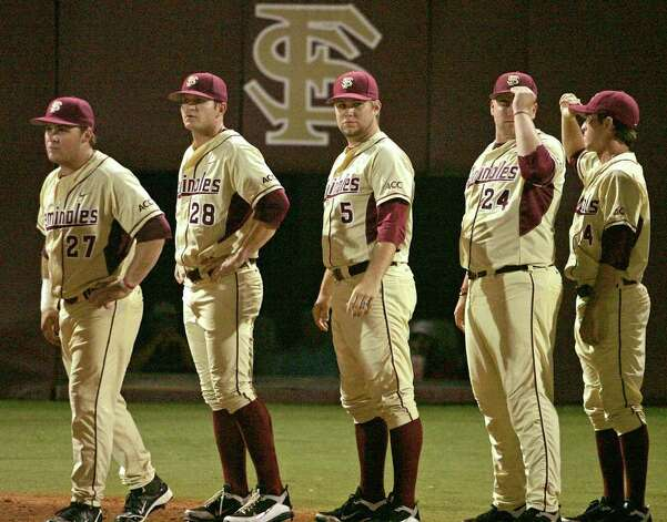 Florida State players Stuart Tapley (from left), Tyler Everett, Jack Posey, Brian Busch and Tye Busckley wait to congratulate Texas A&M players on their 11-2 win in the teams' Super Regional game on Monday, June 13, 2011 in Tallahassee, Fla. Photo: Steve Cannon/Associated Press