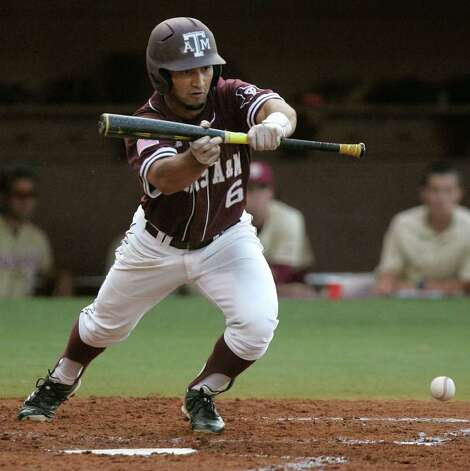 Texas A&M's Andrew Collazo lays down a bunt against Florida State in the first inning of the teams' Super Regional game on Monday, June 13, 2011, in Tallahassee, Fla. Photo: Steve Cannon/Associated Press