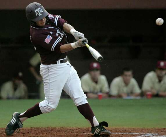 Texas A&M's Kevin Gonzalez swings for a two-run double against Florida State in the first inning of the teams' Super Regional game on Monday, June 13, 2011, in Tallahassee, Fla. Photo: Steve Cannon/Associated Press