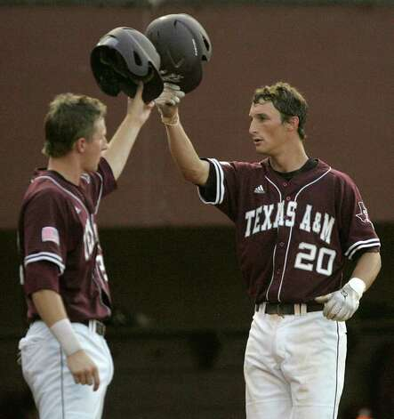 Texas A&M's Adam Smith celebrates with Jacob House (left) after hitting a home run against Florida State in the second inning of the teams' Super Regional game on Monday, June 13, 2011, in Tallahassee, Fla. Photo: Steve Cannon/Associated Press