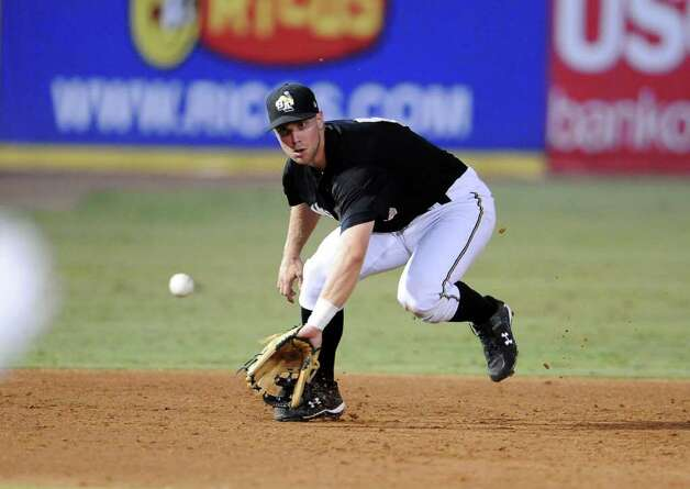 Missions third baseman James Darnell tracks down a ground ball during a game against the Tulsa Drillers at Wolff Stadium last July. Darnell was one of eight Missions players selected for the 75th Texas League All-Star Game. Photo: John Albright/Special To The Express-News / San Antonio Express-News