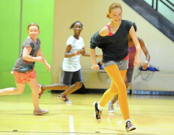 Port arthur triathlon aims to keep kids healthy this for Harris ymca summer camp
