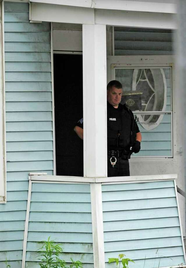 Officers and detectives of the Schenectady Police Department begin the investigation of an early Tuesday morning shooting at 505 Mumford St. A 23-year-old man, who was shot multiple times, was taken to Ellis Hospital. (Skip Dickstein / Times Union) Photo: SKIP DICKSTEIN