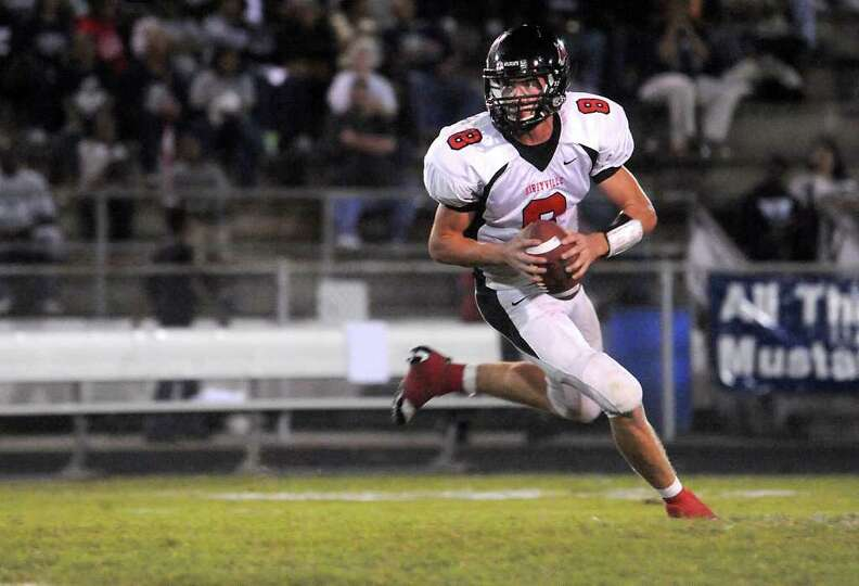 Kirbyville's Caleb Cucancic looks to pass against WO-S at West Orange Stark High School in West Oran