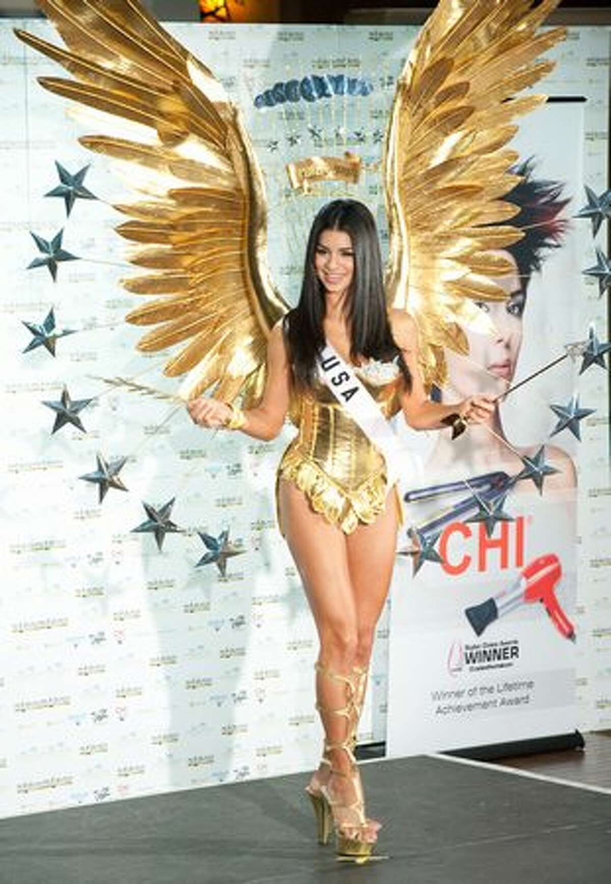Rima Fakih, Miss USA 2010, in a creation inspired by the bald eagle and the presidential seal.