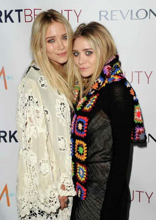 """Twins Mary-Kate and Ashley, who turned 25 on Monday, June 13, 2011, have been in the public eye since infancy, when they took turns playing Michelle Tanner on the TV show """"Full House."""" They have gone on to roles separately and together in other shows and movies, including the animated series """"Mary-Kate and Ashley in Action!"""" But they are more known these days as fashionistas and designers. Here, they attend the launch of MARKTBeauty.com, an online beauty destination at The Penthouse at Smyth Hotel Tribeca on June 8, 2010 in New York City. Photo: Stephen Lovekin, Getty Images / 2010 Getty Images"""