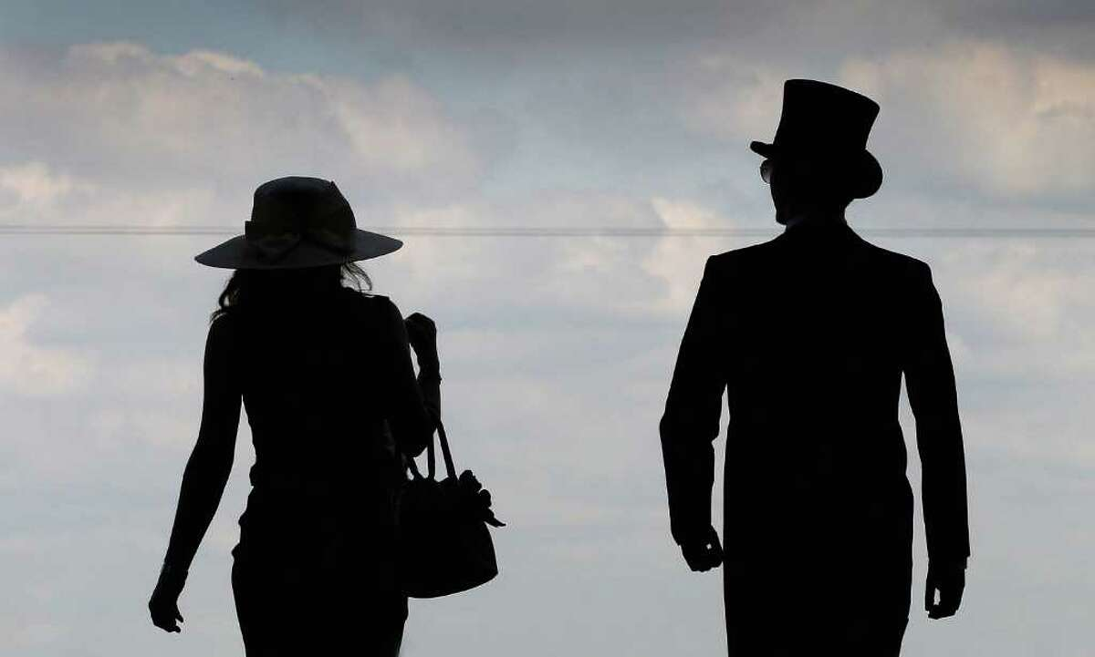 ASCOT, ENGLAND - JUNE 14: Racegoers arrive on the opening day of Royal Ascot at Ascot Racecourse on June 14, 2011 in Ascot, United Kingdom. (Photo by Chris Jackson/Getty Images)