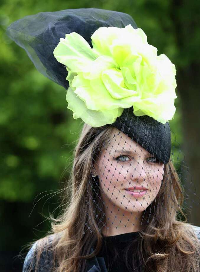 ASCOT, ENGLAND - JUNE 14:  Model Veronica Voronina arrives for the opening day of Royal Ascot at Ascot Racecourse on June 14, 2011 in Ascot, United Kingdom.  (Photo by Chris Jackson/Getty Images) Photo: Chris Jackson, Getty Images / 2011 Getty Images