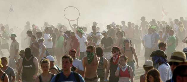 Music lovers battle the heat and dust during the Bonnaroo Music and Arts Festival in Manchester, Tenn., Sunday, June 12, 2011. Photo: AP
