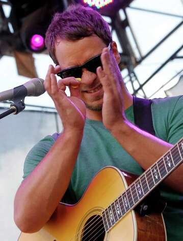 Amos Lee performs during the Bonnaroo Music and Arts Festival in Manchester, Tenn., Sunday, June 12, 2011. Photo: AP