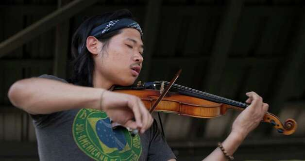 Brian Kim of Aunt Martha performs during the Bonnaroo Music and Arts Festival in Manchester, Tenn., Sunday, June 12, 2011. Photo: AP