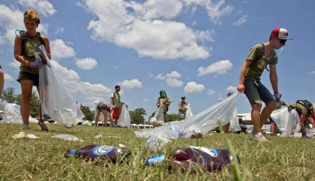 Clean up crews pick up trash in front on the What Stage during the Bonnaroo Music and Arts Festival in Manchester, Tenn., Sunday, June 12, 2011. Photo: AP