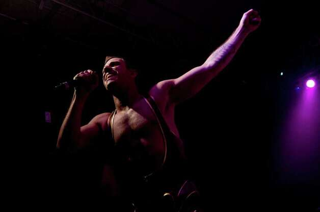 Scissor Sisters front man Jake Shears performs during the Bonnaroo Music and Arts Festival in Manchester, Tenn., early Sunday, June 12, 2011. The Bonnaroo Music and Arts Festival is a four-day, multi-stage camping festival held on a 700-acre farm in Manchester, Tenn. every June. Photo: AP