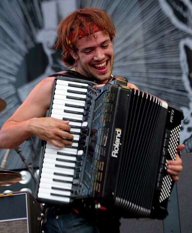 Ben Lovett of Mumford and Sons performs during the Bonnaroo Music and Arts Festival in Manchester, Tenn., Saturday, June 11, 2011. Photo: AP