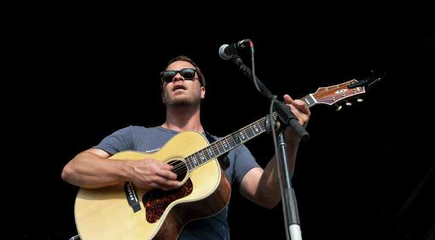 Amos Lee performs during the Bonnaroo Music and Arts Festival in Manchester, Tenn., Saturday, June 11, 2011. Photo: AP