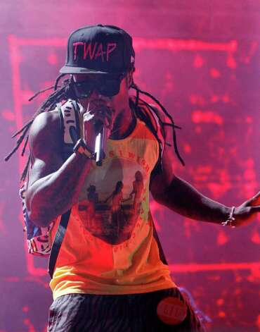Lil Wayne performs during the Bonnaroo Music and Arts Festival in Manchester, Tenn., early Saturday, June 11, 2011. Photo: AP