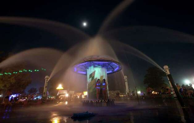 Music lovers cool off under the Centeroo Fountain during the Bonnaroo Music Festival in Manchester, Tenn., Friday, June 10, 2011. Photo: AP