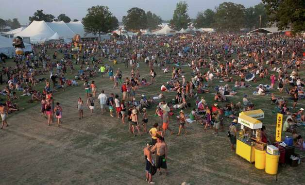 Music lovers rest and listen to music during the Bonnaroo Music and Arts Festival in Manchester, Tenn., Friday, June 10, 2011. Photo: AP
