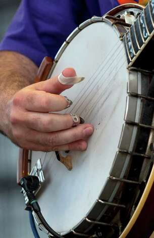 Bela Fleck of Bela Fleck and the Flecktones performs during the Bonnaroo Music Festival in Manchester, Tenn., Friday, June 10, 2011. Photo: AP