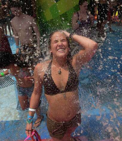 Ana McCormick of Nashville, Tenn., cools off during the opening day of the Bonnaroo Music Festival in Manchester, Tenn., Thursday, June 9, 2011. Photo: AP
