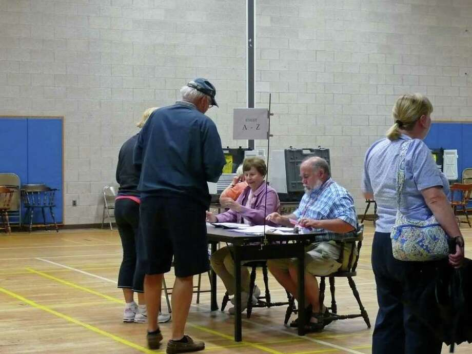 Residents in District 1 show up Tuesday morning at the Senior Center to cast their vote in the referendum to determine if $800,000 should be added back to the Board of Education budget. As of 9:30 a.m., 132 votes had been cast in District 1. Polls are open until 8 p.m. Photo: Genevieve Reilly / Fairfield Citizen