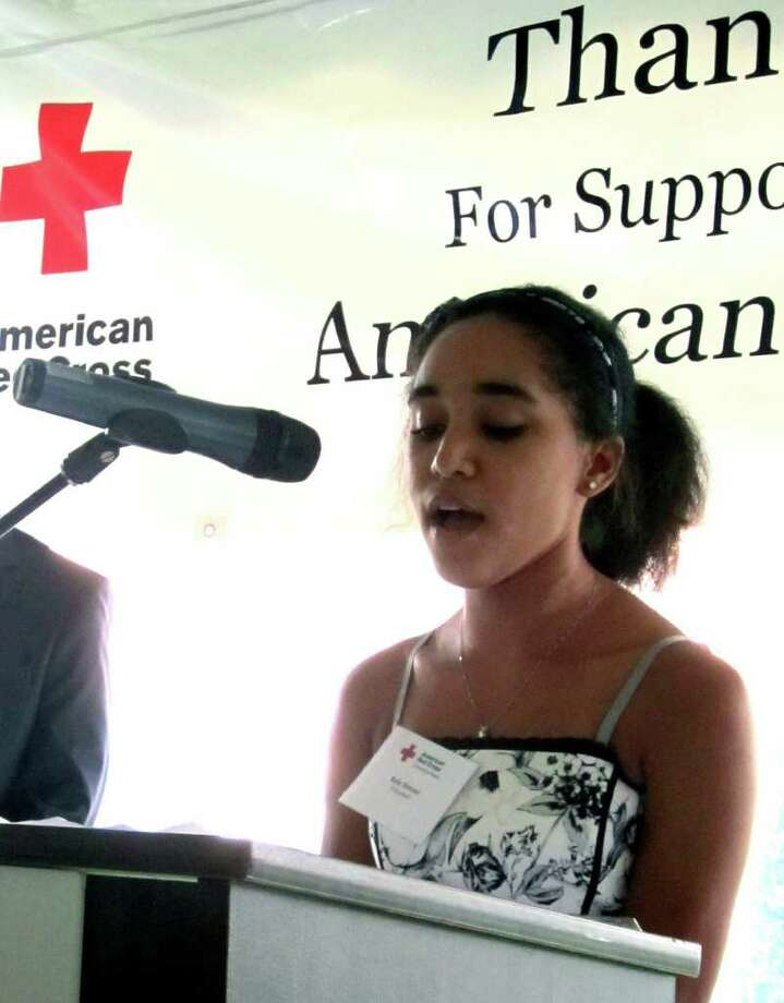 """SPECTRUM/Sherman resident Brie Brown, a Red Cross volunteer and recent graduate of Canterbury School, performs a stirring rendition of """"Amazing Grace"""" during the 13th annual benefit """"Breakfast on the Green"""" hosted Friday, June 10, 2011 on the Village Green in New Milford by the American Red Cross Connecticut Region. Photo: Norm Cummings / The News-Times"""