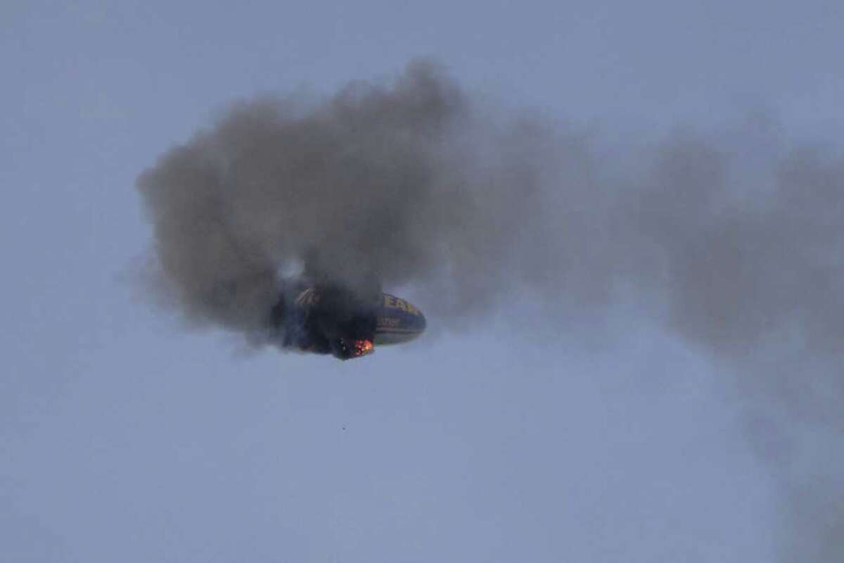 A Goodyear blimp crashes near Oberursel, western Germany, on Sunday. The pilot of the blimp was killed and three passengers had to leap to safety when the aircraft caught fire and crashed, a police spokesman said. The blimp had been making a promotional flight to mark a local festival.