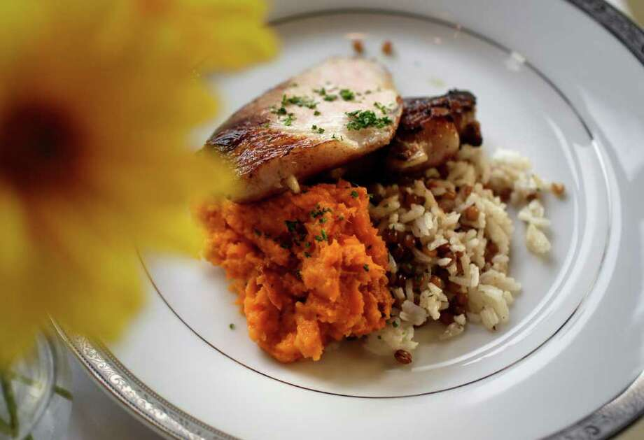 Pork chop à la Bayonnaise with sweet potatoes and pilaf is an example of a seemingly common dish elevated with careful ingredient selection and impeccable technique. Photo: BOB OWEN, SAN ANTONIO EXPRESS-NEWS / rowen@express-news.net