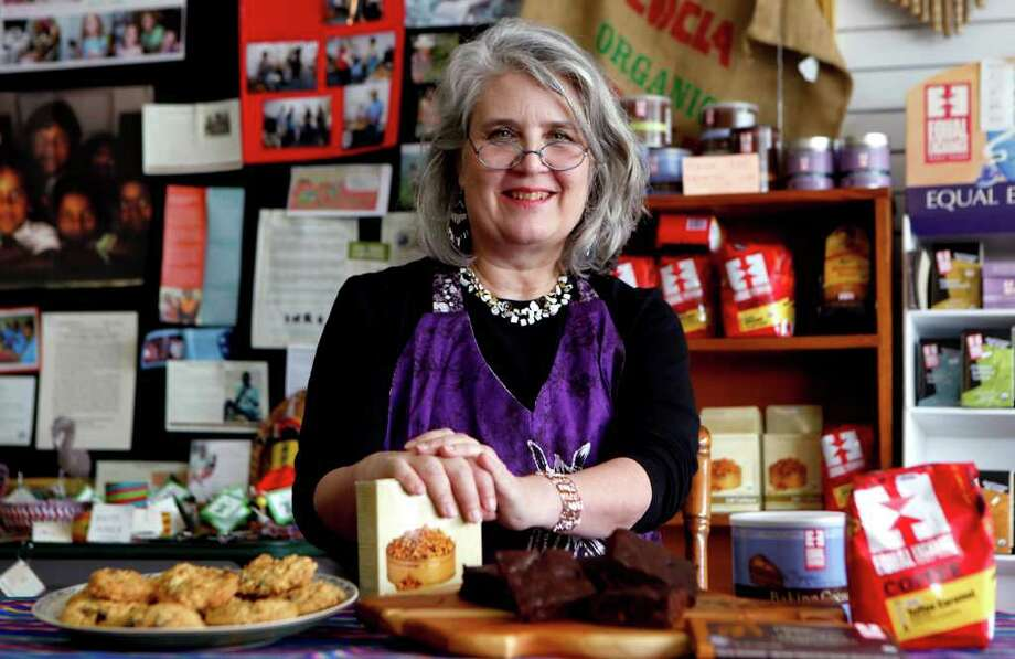Hollye Schwartz shows some favorite foodstuffs in her store, All's Fair. Photo: WILLIAM LUTHER, SAN ANTONIO EXPRESS-NEWS / WILLIAM LUTHER