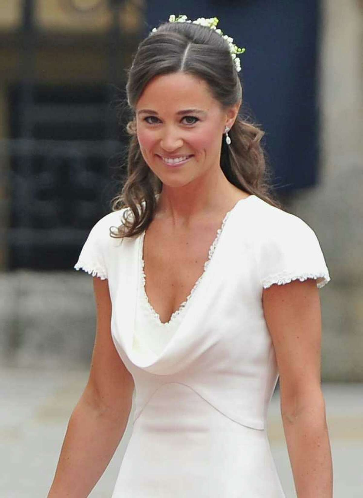 LONDON, ENGLAND - APRIL 29: Sister of the bride and Maid of Honour Pippa Middleton arrives to attend the Royal Wedding of Prince William to Catherine Middleton at Westminster Abbey on April 29, 2011 in London, England. The marriage of the second in line to the British throne is to be led by the Archbishop of Canterbury and will be attended by 1900 guests, including foreign Royal family members and heads of state. Thousands of well-wishers from around the world have also flocked to London to witness the spectacle and pageantry of the Royal Wedding. (Photo by Pascal Le Segretain/Getty Images) *** Local Caption *** Pippa Middleton;